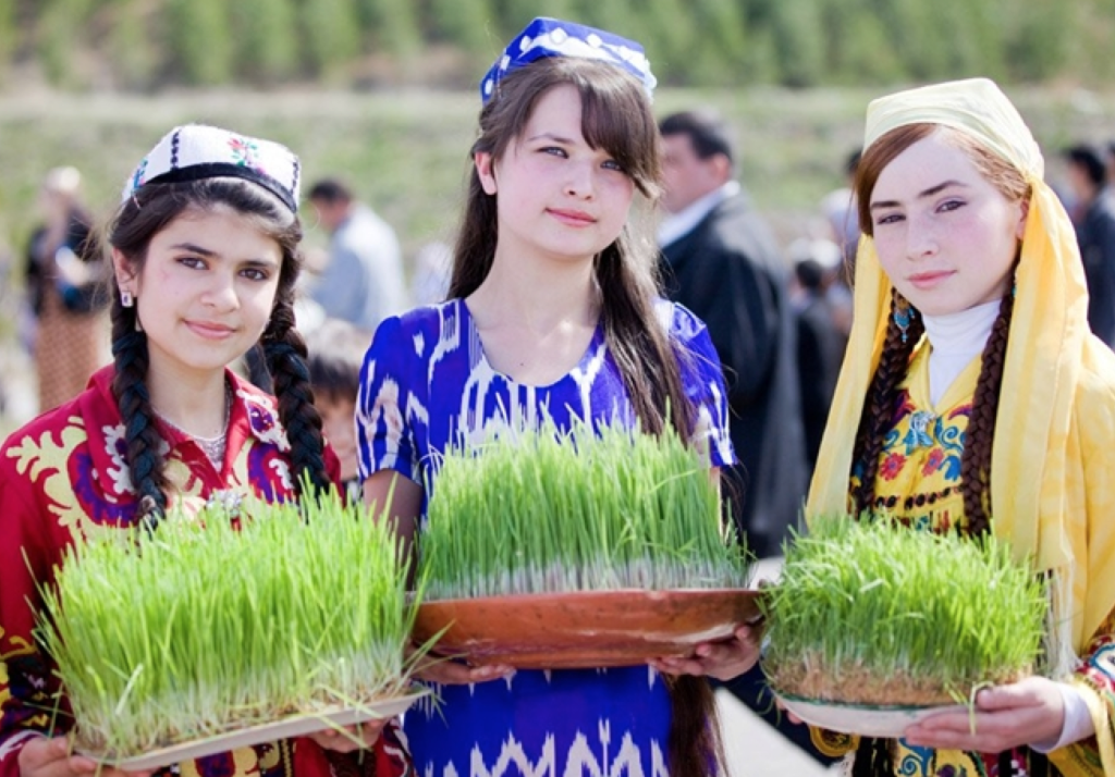 Tajik girls celebrate the Iranian Nowruz (New Year) on March 21, 2014 in Dushanbe, Tajikestan.