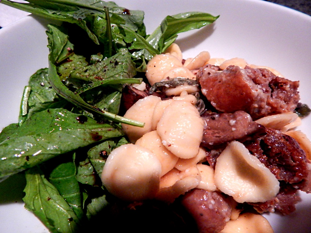 orecchiette, with sage, mushrooms and sausage, on a bed of arugula.