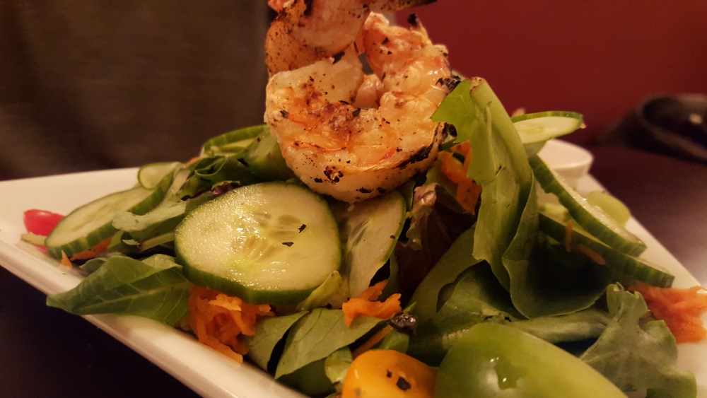 The Vault Mesclun salad with grilled shrimp