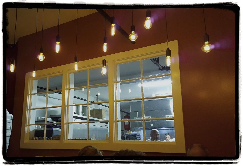 liberty-street-bistro-kitchen-window-framed